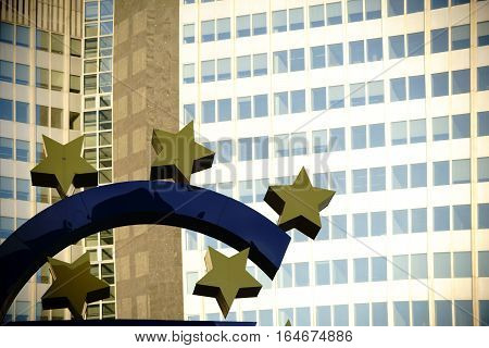 FRANKFURT, GERMANY - JANUARY 05: A section of the Euro sculpture on the Willy-Brandt-Square in front of the windows of the Euro Tower skyscraper on January 05, 2017 in Frankfurt.