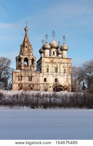 Journey to the North of Russia. Church of St. John Chrysostom with bell tower in Vologda. View from the frozen Vologda River. Photo in frosty sunny winter day.