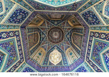 Shiraz Iran - October 23 2016: Ceiling of main entrance to Shah Cheragh Mosque and mausoleum in Shiraz city in Iran
