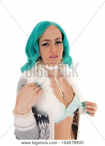 A lovely young woman wearing a knitted jacket and light blue bra with long blue hair isolated for white background.