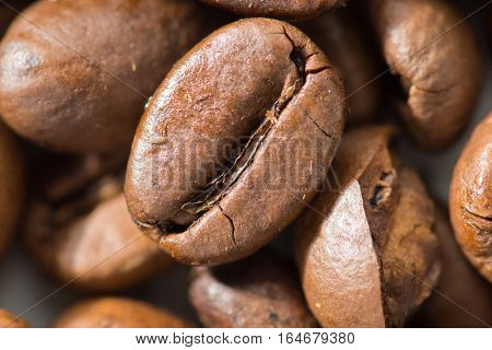 Background from coffee beans Arabica beans closeup