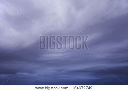 Blue purple clouds with white gleams and soft wavy texture