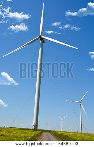 Wind energy turbine on blue sky background