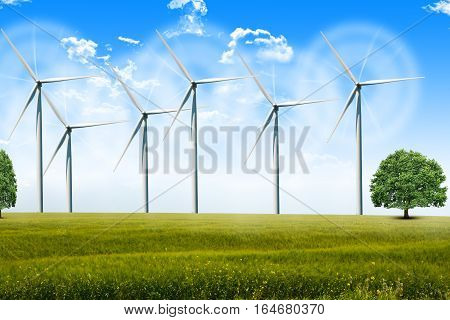 Wind energy turbines spinning on agricultural field on a summer day
