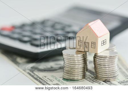 House property prices concept with money pillars from coins