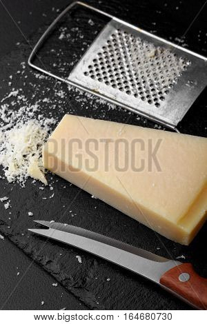 Parmesan Cheese With A Grater.cocnept Proces With Food . Grater Cheese