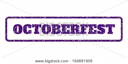 Indigo Blue rubber seal stamp with Octoberfest text. Vector message inside rounded rectangular banner. Grunge design and unclean texture for watermark labels. Horisontal sticker on a white background.