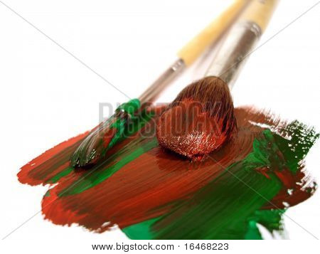 two brushes with red and green paints