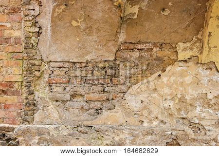 Old bricks and concrete. Aged wall surface. Time is merciless.