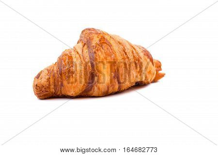 Fresh Croissant isolated on white background. Croissant is a French crescent-shaped roll made of sweet flaky pastry often eaten for breakfast.