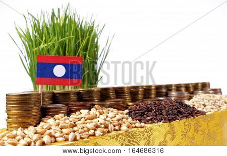 Laos Flag Waving With Stack Of Money Coins And Piles Of Wheat And Rice Seeds