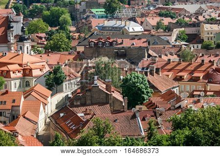 Town at daytime. Buildings with red rooftops. Visit Europe in summer.