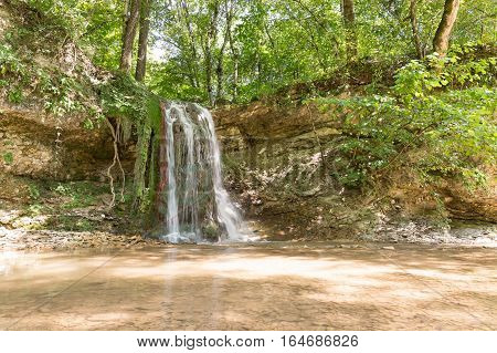 Waterfall on a mountain river Khodz. Russia Krasnodar Krai