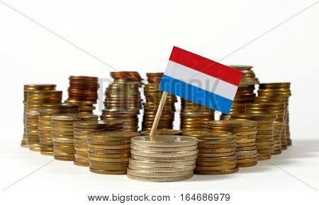 Luxembourg Flag Waving With Stack Of Money Coins