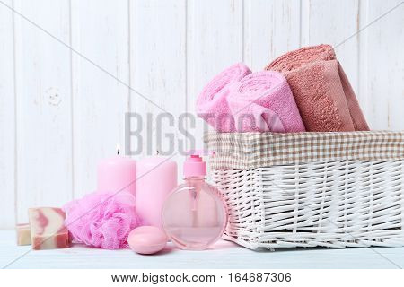 Towels With Soap And Wisp On White Wall Paneling Background