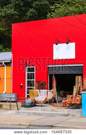 Asheville NC, USA - September 12: The bright red Eclectic furnishings  warehouse building in the River Arts District of Asheville NC