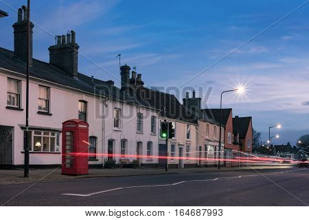 Long Melford HIgh Street in Suffolk, captured at dusk with passing traffic blurred bu the long exposure