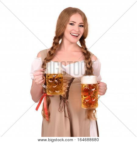 sexy woman wearing a dirndl with two beer mugs over white.