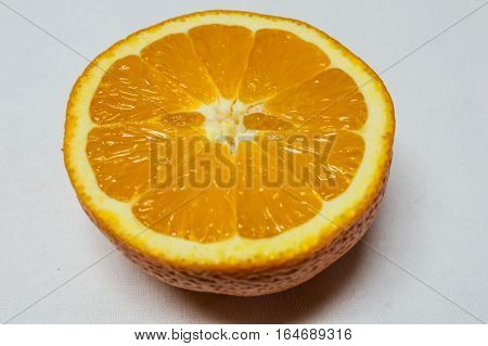 Close-up orange cut in half ready to wringing -squeezing isolated on white background.
