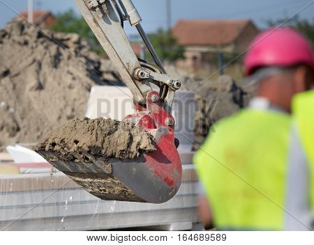 Excavator Bucket Loaded With Dirt