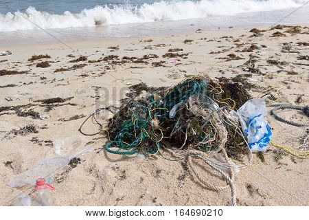 Plastic pollution, washed up on the beach. The sea is much polluted by plastic.