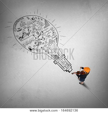 Top view of engineer woman and business strategy sketches on floor
