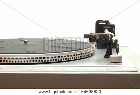Turntable with empty disk isolated on white front view closeup