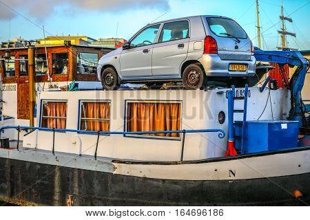 AMSTERDAM NETHERLANDS - JANUARY 02 2017: Boats on water in cloudy evening January 02 2017 in Amsterdam - Netherland.