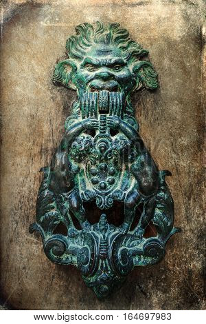 Antique Doorknocker On Grunge Texture