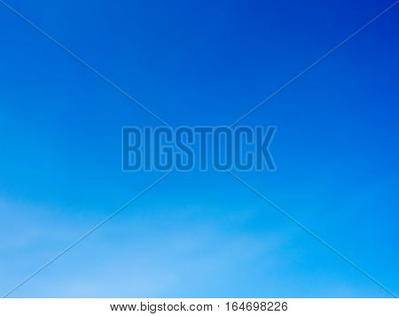 Blue vivid sky with smooth faded cloud.
