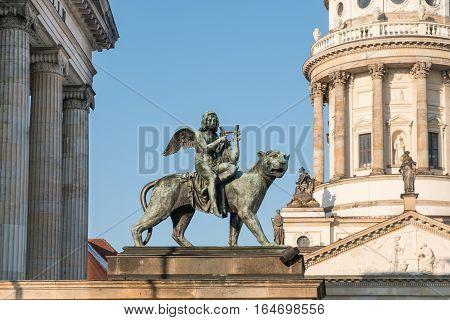 Angel statue at Konzerthaus Berlin Gendarmenmarkt, french dome