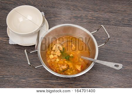 Traditional hungarian dish hot goulash with potatoes