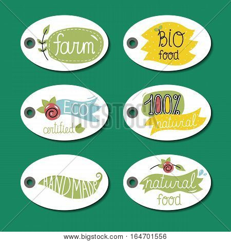 Eco and bio food labels set isolated on green background. Natural farm products round price tags. Certified eco friendly products. Vegetarian food diet. Healthy eating concept.