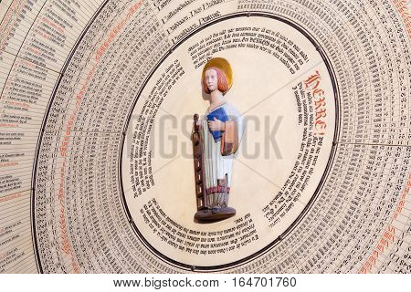Lund, Sweden, Aug 29, 2016 - The calendar of the astronomical clock in Lund Cathedral. The Saint St. Lawrence stands in the center with a grill and a book in his hands.