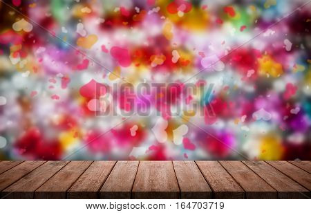 Valentines day background with many colorful Hearts shape in front of an empty wooden table