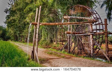 old wooden watermill working in farm in countryside