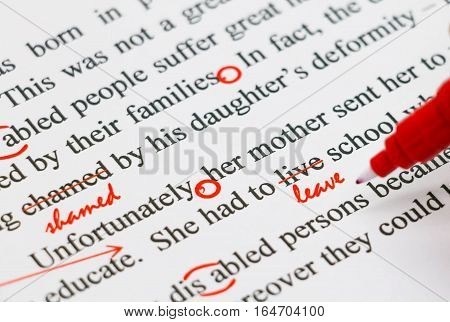 closeup red marks on proofreading english document