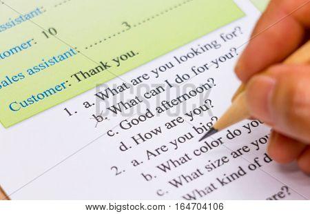 closeup english multiple choice exam sheet about conversation