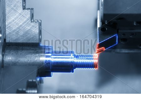 Abstract scene of CNC lath machine (Turning machine) while cutting the screw thread with glowing edge lighting effect