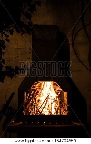Traditional outdoor stone oven for cooking and grilling at the evening