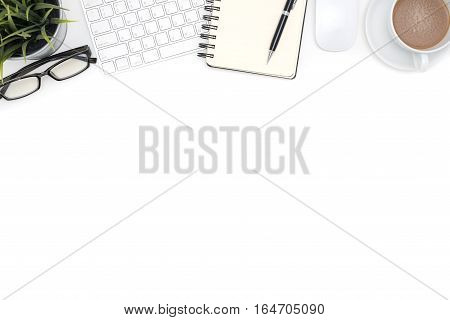 White office desk table with computer supplies eye glasses and coffee cup Top view with copy space