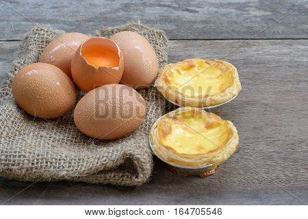 Egg tart custard sweet delicious dessert on wood table