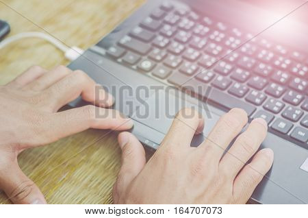 Working at home with laptop male hands on the keyboard