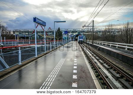 AMSTERDAM NETHERLANDS - JANUARY 03 2017: Metro station of Amsterdam with opened platform close-up construction elements. Amsterdam - Netherlands.