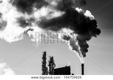 Dark smoke from the chimney of industrial factory
