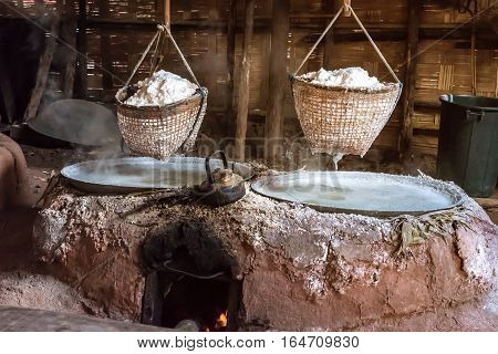 Traditional salt making by boiling underground salt water. Nan province Thailand.