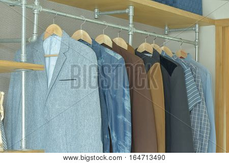 Men Casual Suits Hanging In Modern Industrial Style Walk In Closet