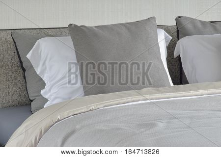 Gray Pillow On White Setting On Bed With Comfy Blanket