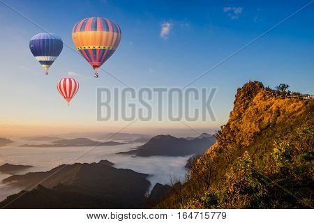 Colorful Hot-air Balloons Flying Over The Mountain At Phu Chee Dao Peak Of Mountain In Chiang Rai, T