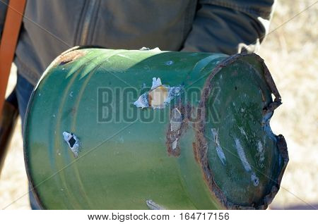 bucket was used as a target for shooting from a gun